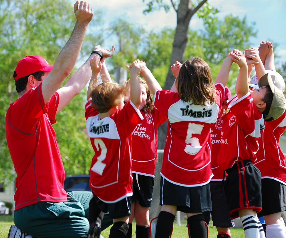 Children's soccer team cheering.
