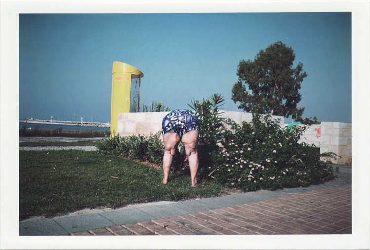 dirty photos - on the island of - photo of bending old woman with funny swimming suit near the beach