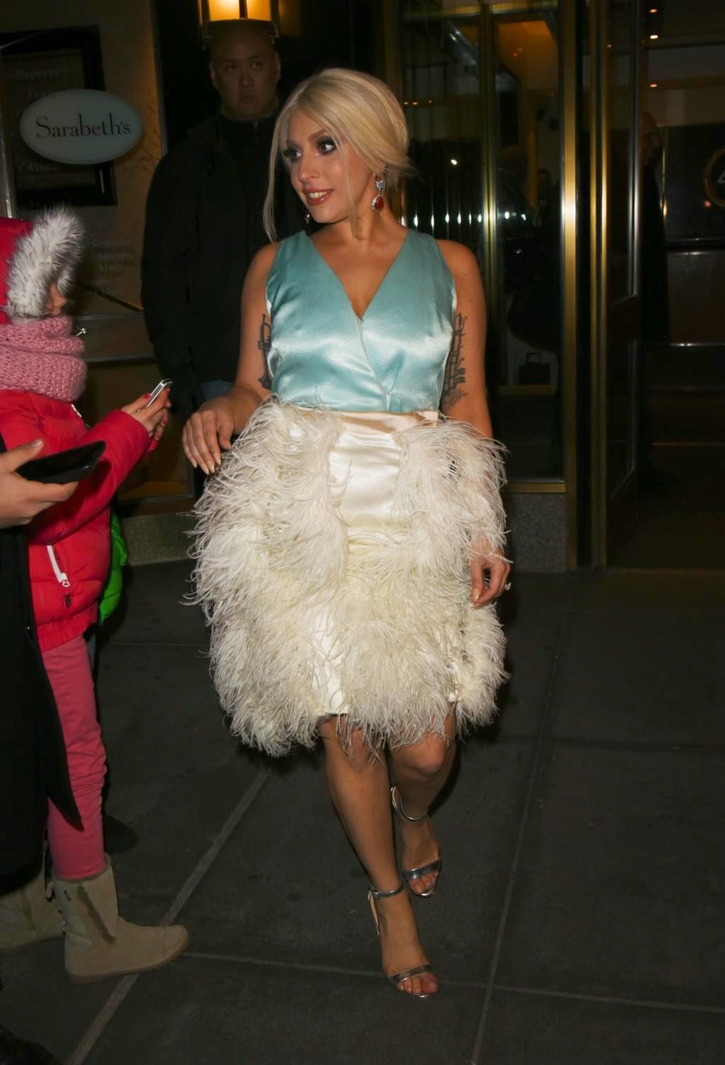 Singer: Lady Gaga - In New York And poses For pictures With Fans In A Ruffled Feather