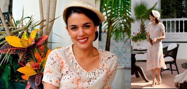 Sira Quiroga vestido blanco con siluetas flores naranja y morado. El tiempo entre costuras. Capítulo 4.