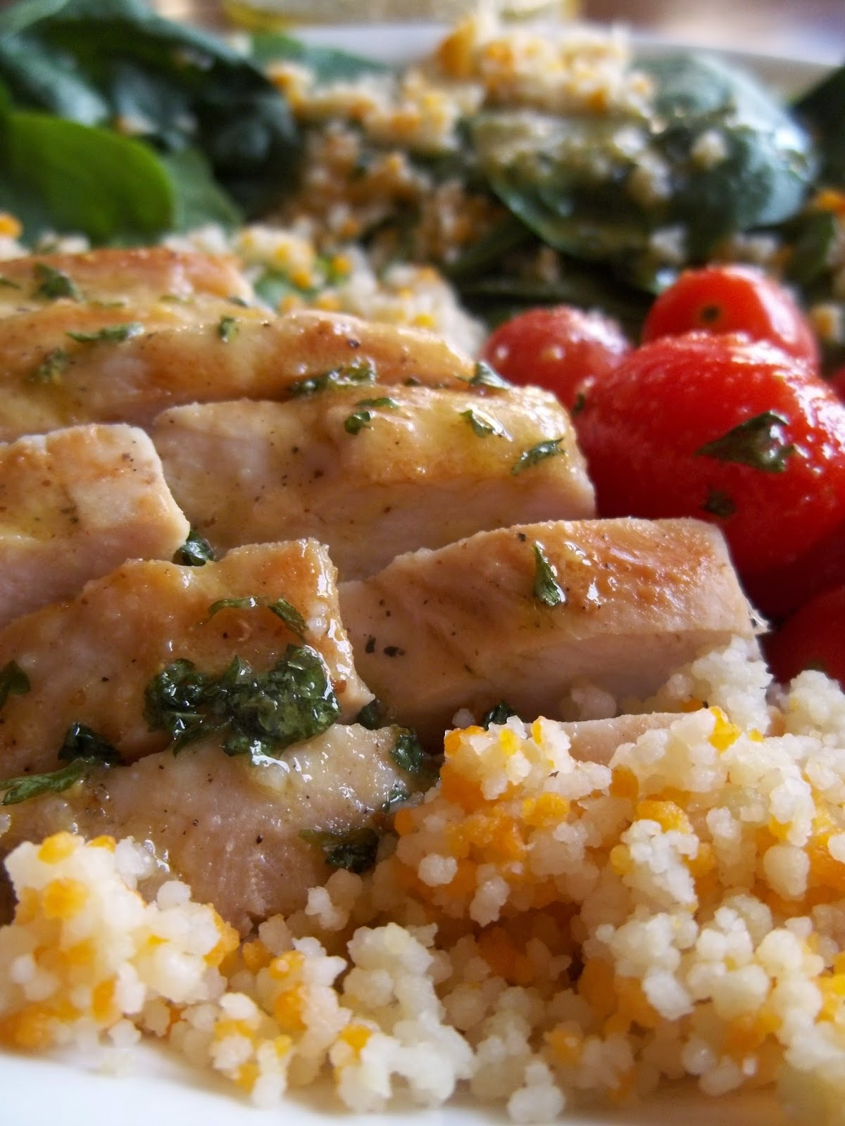 Grilled chicken, couscous, spinach and tomato salad with homemade vinaigrette.