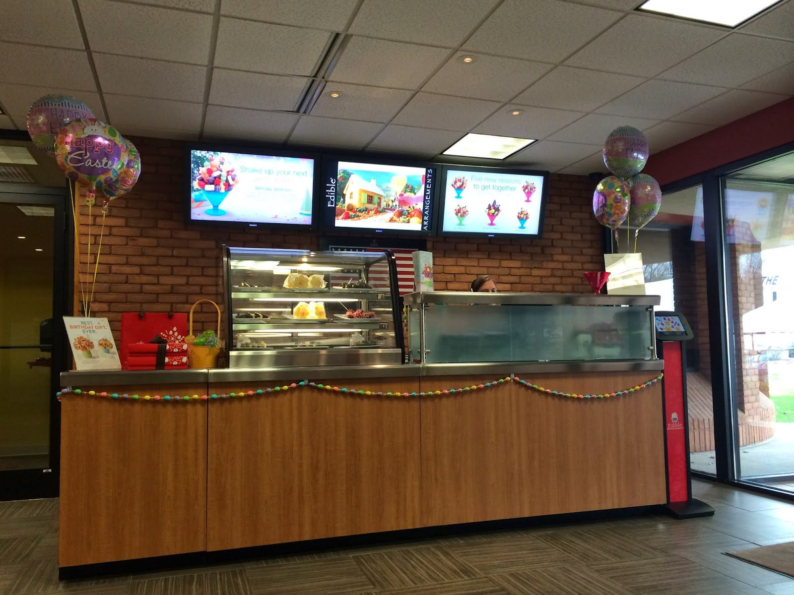 hockey mom stitchin hobby  reception desk and lobby of the edible arrangements office in wallingford ct fun way to be greeted at the corporate office looks like the lobby front of