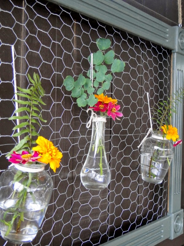 http://www.salvagesavvy.com/2014/07/diy-chicken-wire-frame-with-bud-vases.html