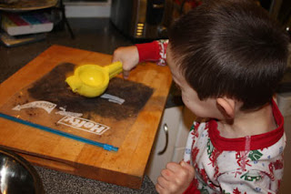 "Sammy crushing the cookies to make ""cookie dirt"""