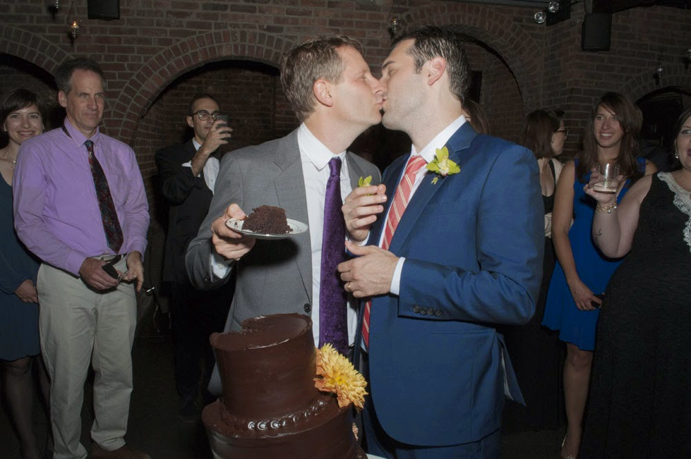 Fall Foundry LIC Wedding cake cutting kiss