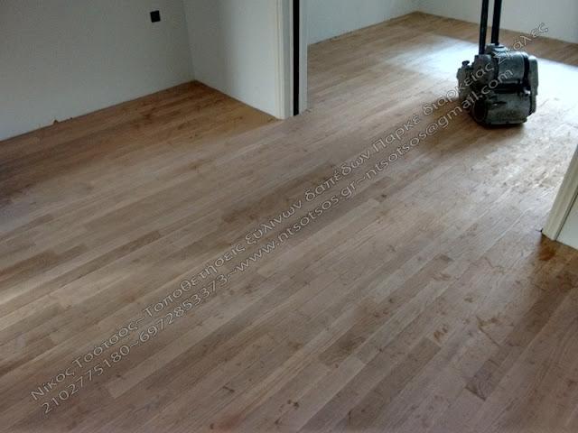 κολλητό ξύλινο πάτωμα πάνω σε μωσαϊκό