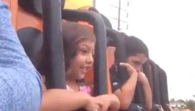 See how this little girl reacts on one of the amusement rides.