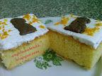 Húsvéti francia narancsos szelet, kevert tésztás, tejtermék mentes sütemény, mandulaforgáccsal és tojásfehérjehabbal.