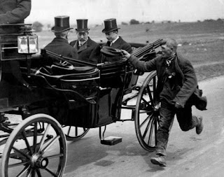 Old photo of poor man chasing plutocrats for some alms
