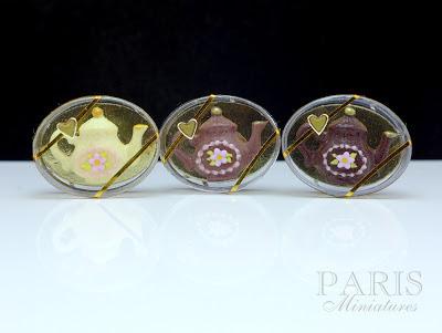 Miniature chocolate teapots in white, milk and dark chocolate