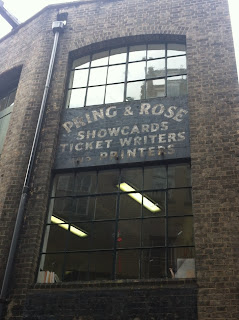 Ghost sign for Pring and Rose, Showcards, Ticket Writers and Printers, Marylebone Passage, London W1