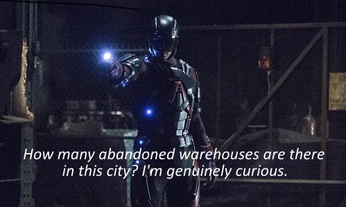 Screenshot of a white man in a blue and red armoured super suit standing in a dark, abandoned warehouse. The caption reads, 'How many abandoned warehouses are there in this city? I'm genuinely curious.'