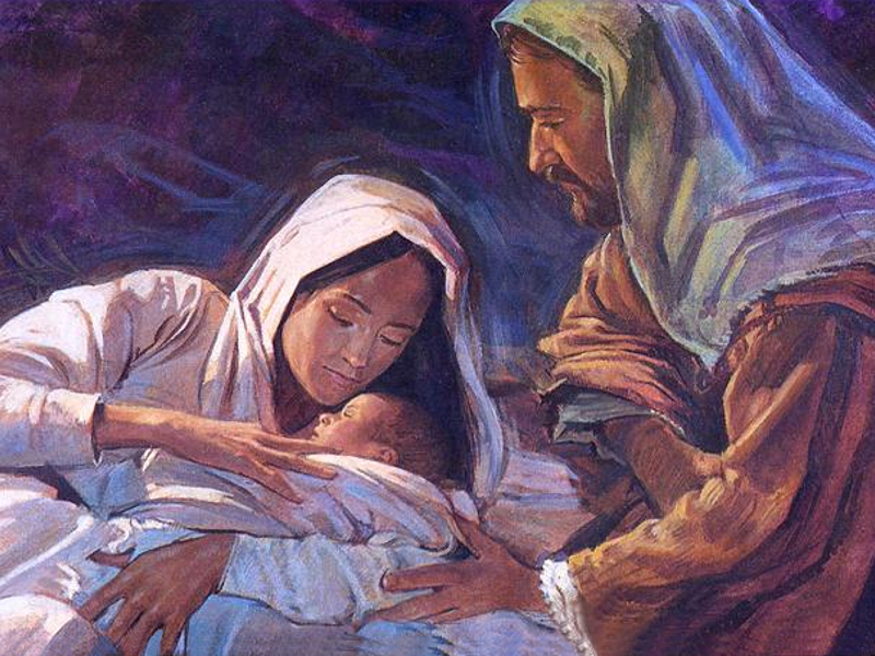 Mary and joseph hold the baby jesus
