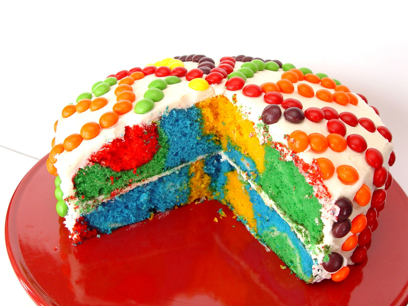 Bright and Cheerful Rainbow Cake | Jamie Cooks It Up - Family ...