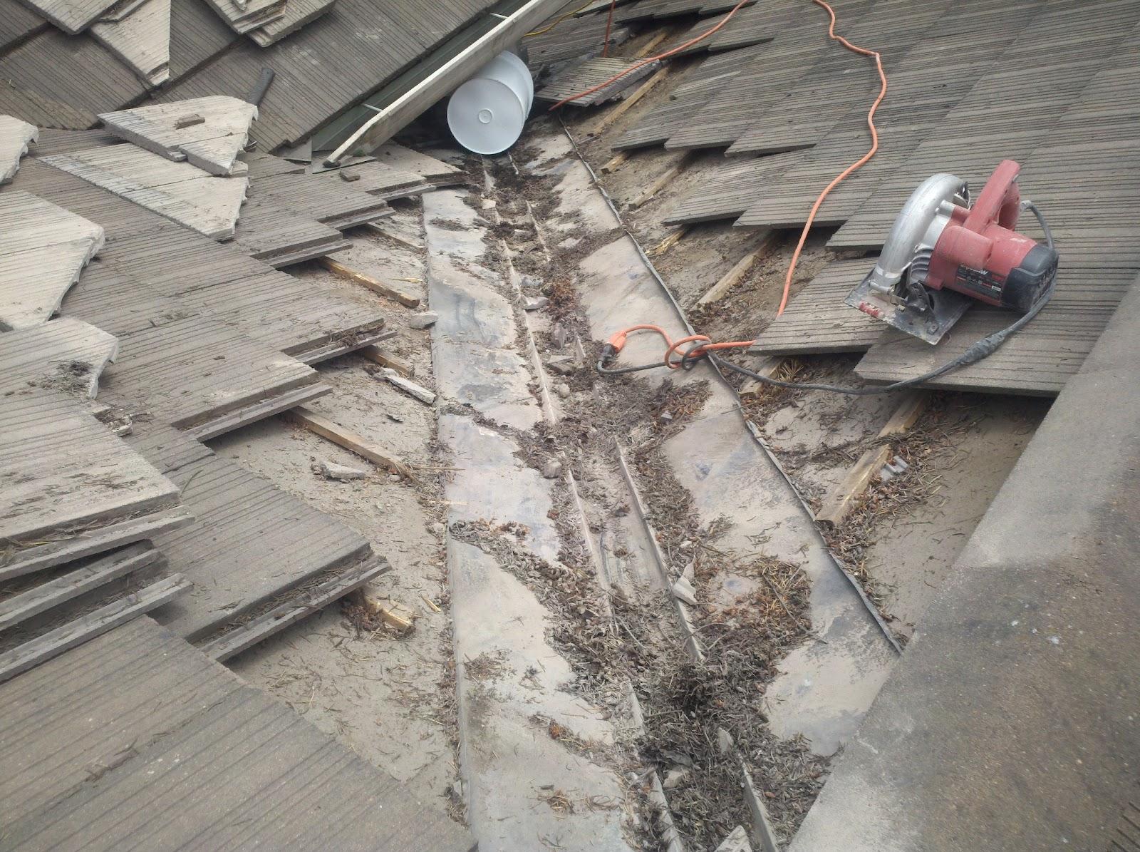 Debris Buildup Under Tiles On Valley Metal.
