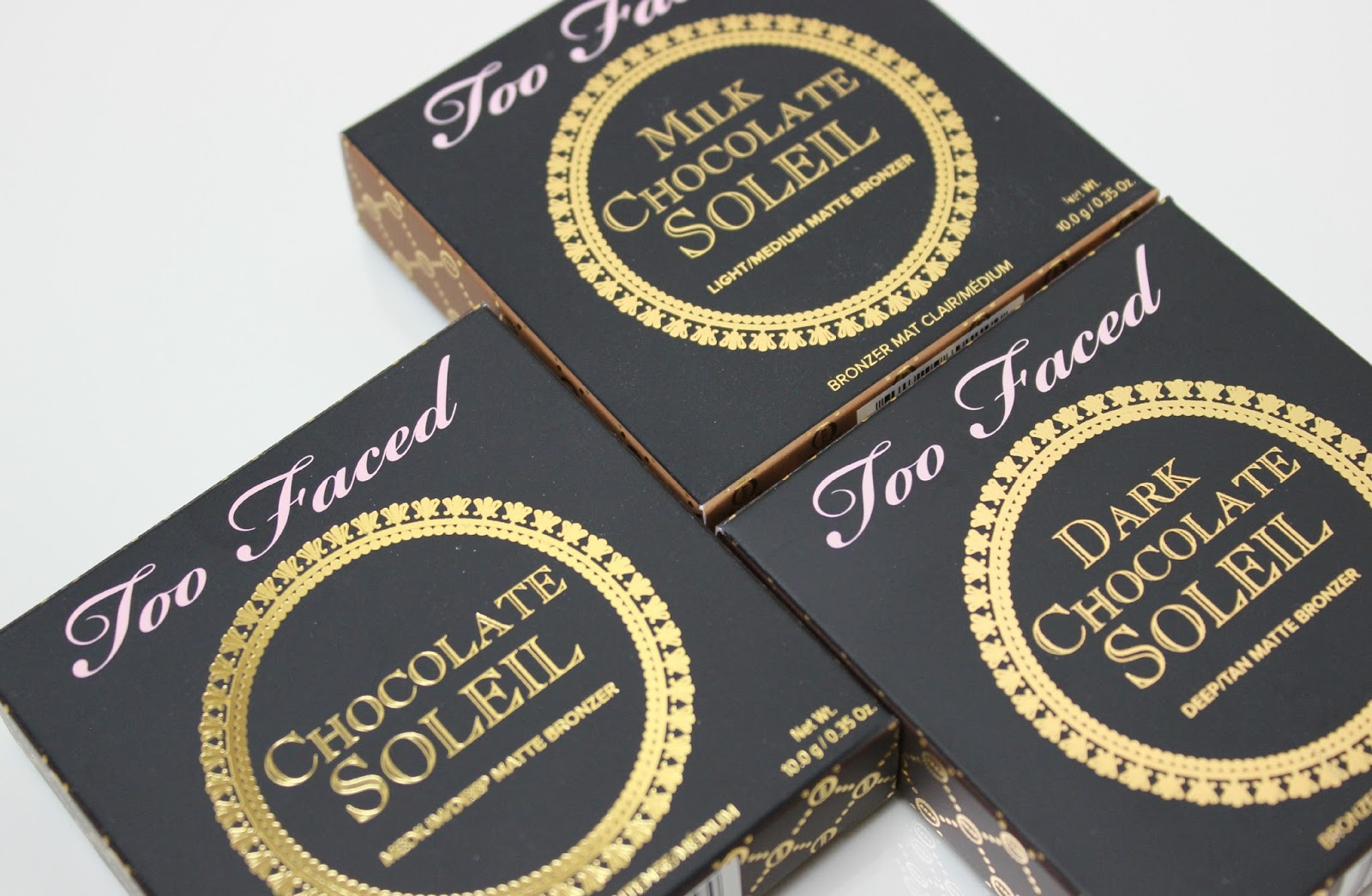 A picture of Too Faced Milk Chocolate Soleil, Chocolate Soleil and Dark Chocolate Soleil