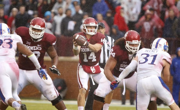 Quarterback Cody Thomas #14 of the Oklahoma Sooners takes a snap during the game against the Kansas Jayhawks November 22, 2014 at Gaylord Family-Oklahoma Memorial Stadium in Norman, Oklahoma. The Sooners defeated the Jayhawks 44-7. (November 21, 2014 - Source: Brett Deering/Getty Images North America)