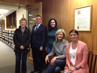 Photograph of members of the Bookclub with Library Director, Ted Gutmann