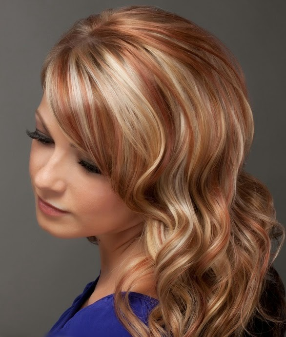 Blonde and Red highlights on long layered hair