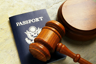 Image illustrating Immigration Crime, with passport and gavel.