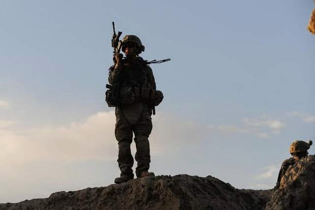 Military News - Report: U.S. may leave fewer troops in Afghanistan