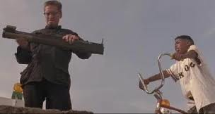 Foster examining rocket launcher Falling Down 1993 Michael Douglas movieloversreviews.blogspot.com