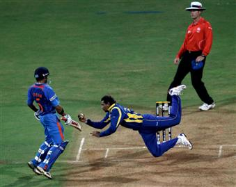 Tillakaratne Dilshan leaps to his right to dismiss Virat Kohli caught-and-bowled, World Cup 2011, Mumbai, April 2, 2011