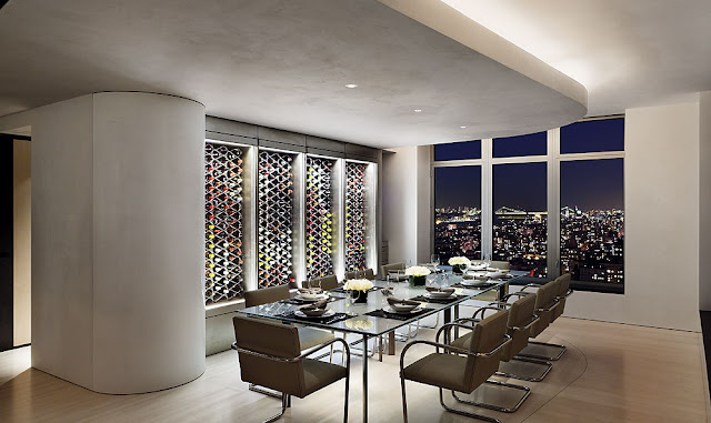 Photo of modern dinning room at night with wine wall