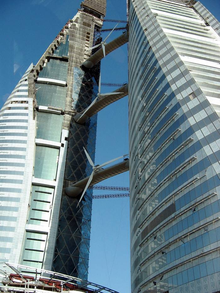 The Bahrain World Trade Center is a 240 m (787 ft) high twin tower complex located in Manama, Bahrain. The towers were built in 2008 by the multi-national architectural firm Atkins. It is the first skyscraper in the world to integrate wind turbines into its design. The wind turbines were developed, built and installed by Danish company Norwin A/S. This 50-floor structure is constructed in close proximity to the King Faisal Highway, near popular landmarks such as the towers of BFH, NBB and Abraj Al Lulu.