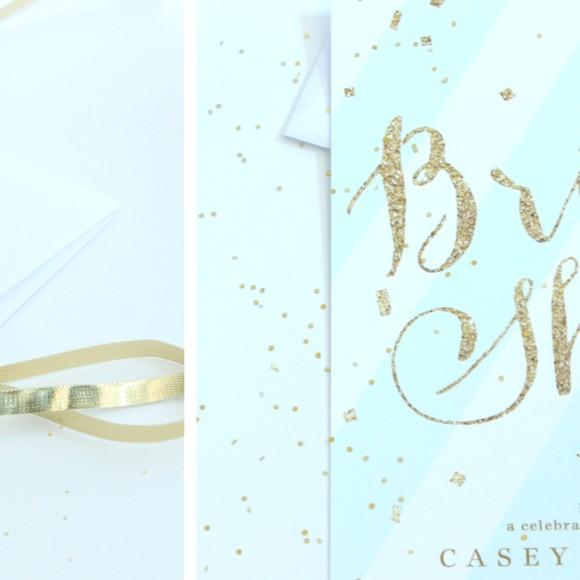 Glitzy gold bridal shower invitations