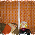 Pops of Orange Make a Ho-Hum Living Room Come to Life!