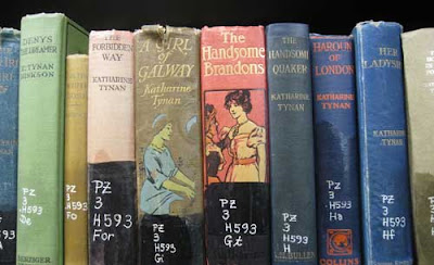 Close up of books showing illustrated spines