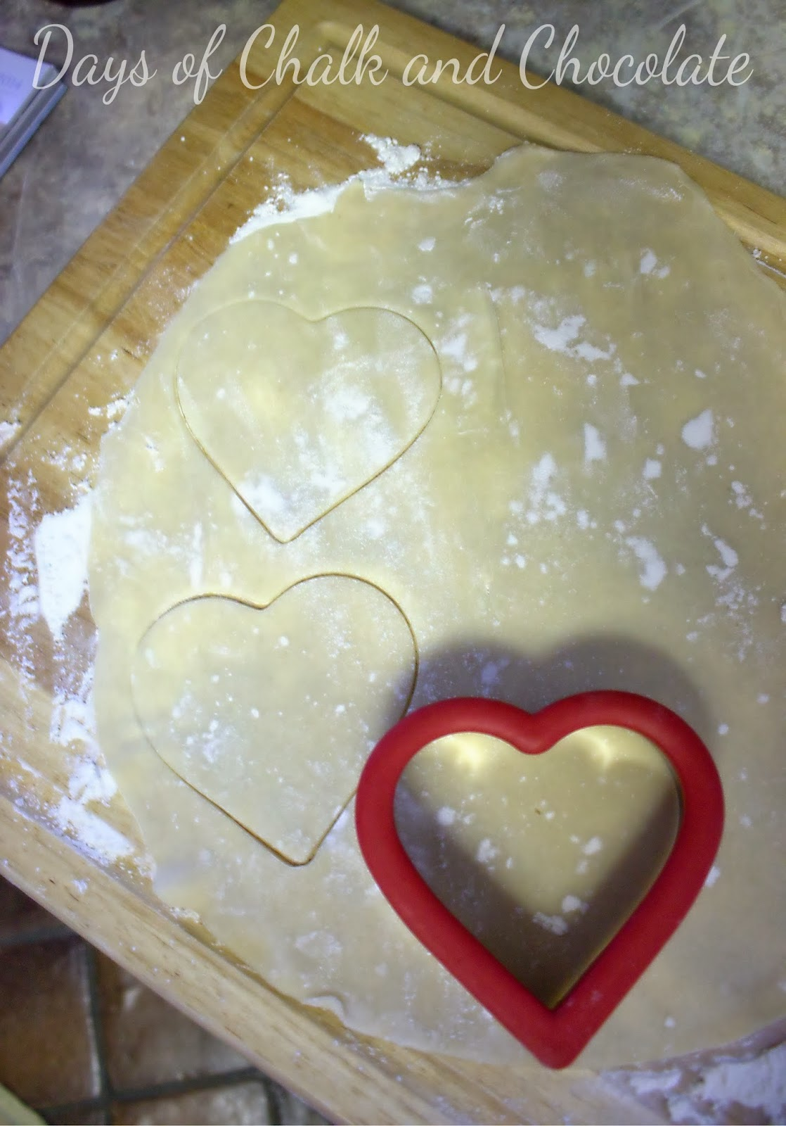 Using a large cookie cutter, cut out an even amount of dough shapes ...