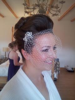 Wedding hair with birdcage veil