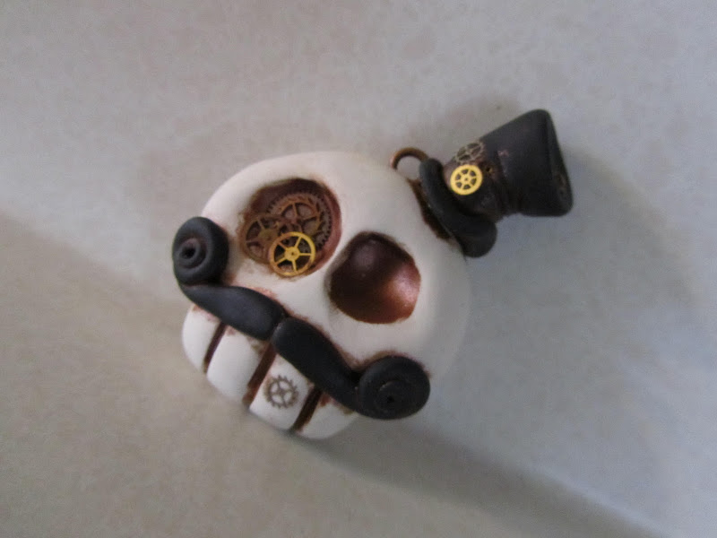 Here is a dapper Steampunk skull, complete with title=