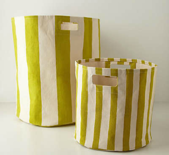 inspired by these anthropologie baskets, give your plain storage bins a quick makeover with a little bit of paint! candy striped bins DIY by pretty providence