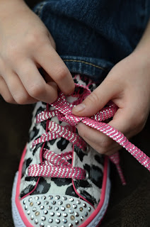 learning to tie shoes; put the top lace under the bottom lace