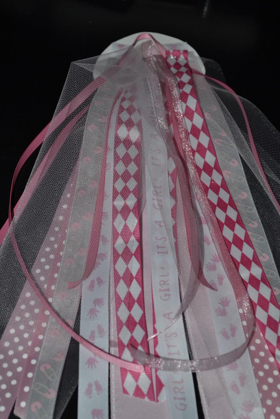 i did the widest ribbon first so that it would be in the back and just kept adding ribbons usually one on each side of the thick back ribbons