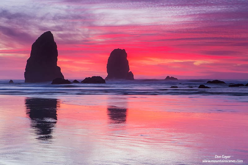 Pink morning clouds above The Needles at Cannon Beach, Oregon.