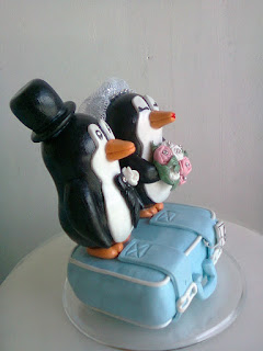 PINGUINS EM CIMA DA MALA