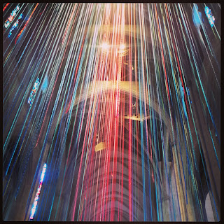Light shining on the ribbons hanging from the ceiling of Grace Cathedral