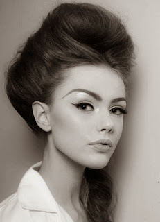 model with a modern twist on the beehive from the 1960's