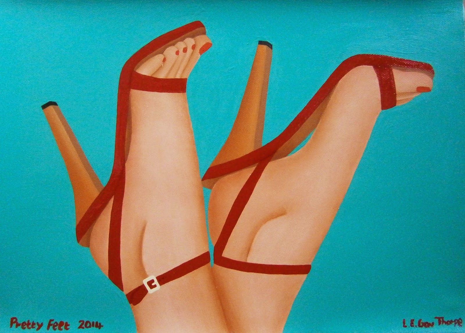 The feet of a woman wearing red high heel sandals