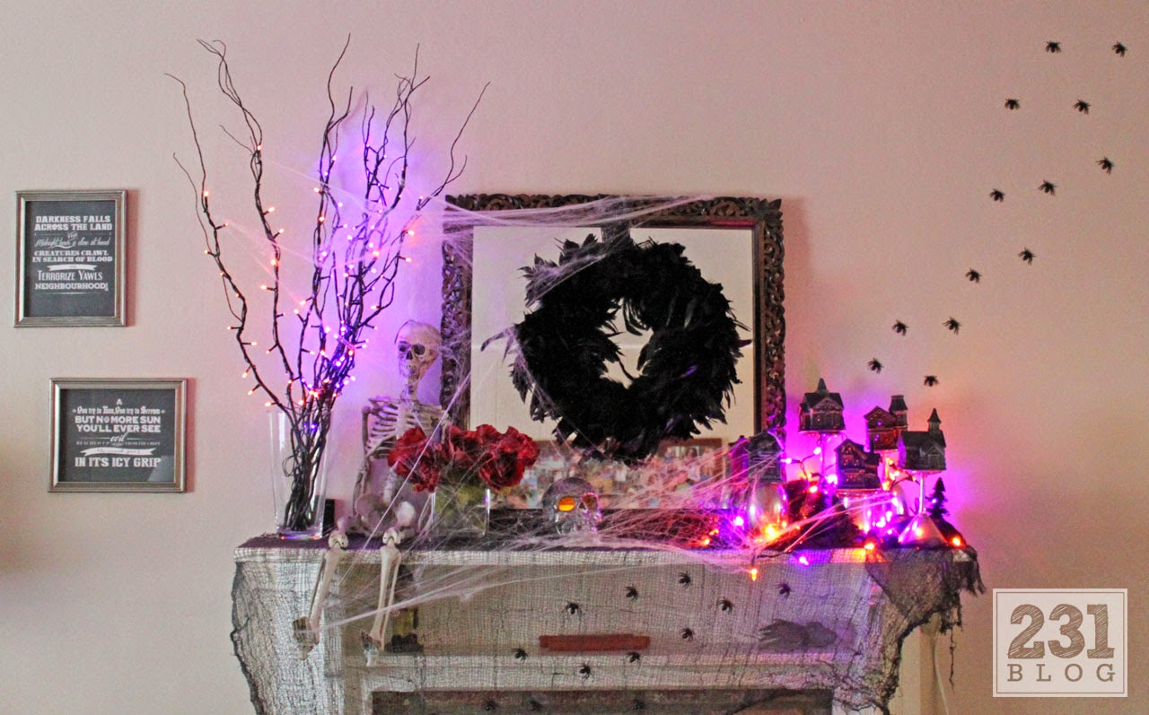 spooky halloween mantel with skelteons and cobwebs