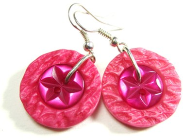 Bold earrings have flower buttons layered over colorful textured buttons