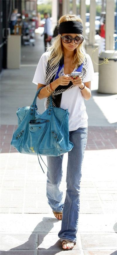Black bandana, colorful scarf, white shirt, jeans and hand bag for summers
