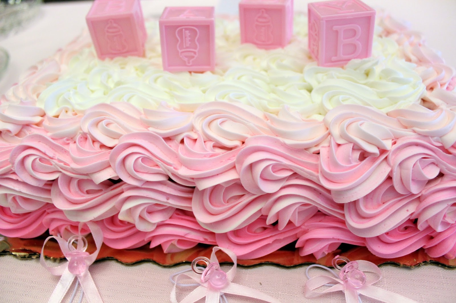Sheet Cakes With Tutu Onesies On Them