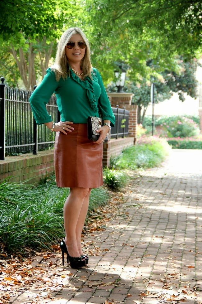 Leather Skirt - Zara, Shirt - Ruffled Picea Buttondown - Anthropologie, Clutch - Vince Camuto via TJ Maxx, Aviator Sunglasses - Ray Ban, Necklace c/o Carolee, Bracelet - Forever 21, Watch - Michael Kors Mid-Size Silver Color Golden Stainless Steel Camille Chronograph, Green Peep-Toe Pumps - Brian Atwood
