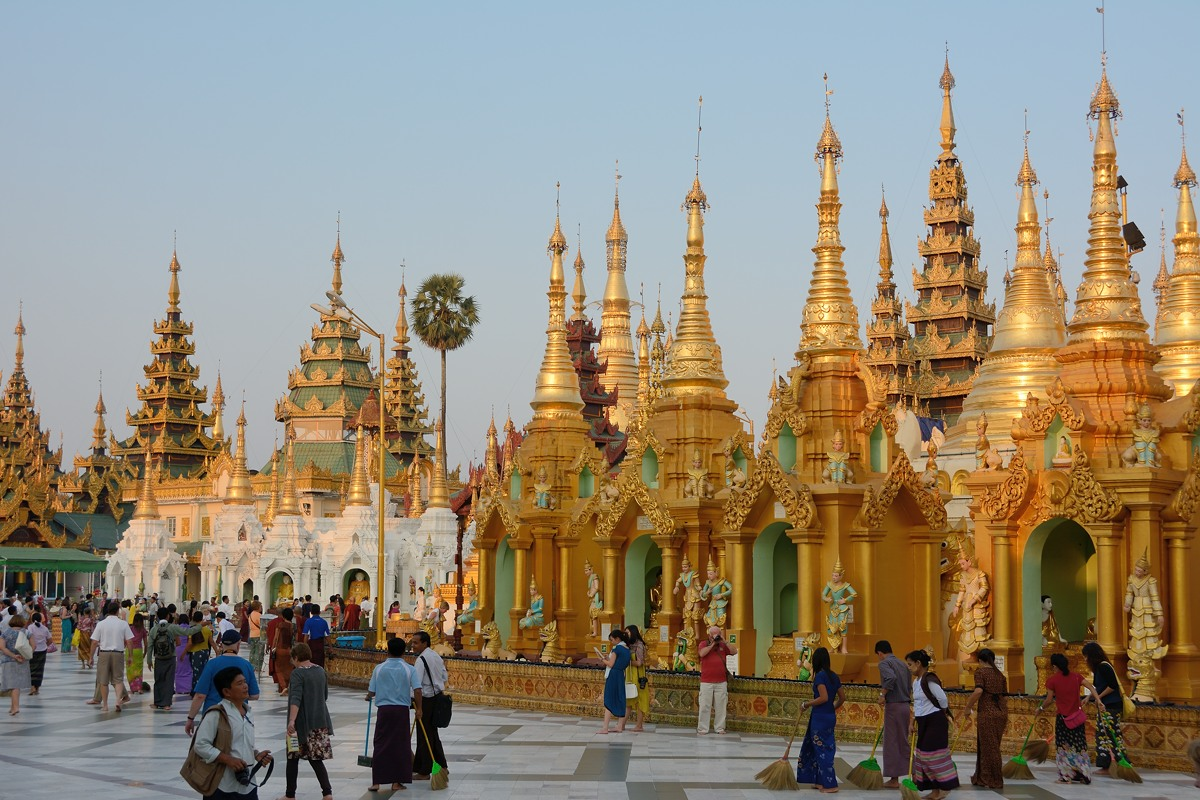 Devotees sweeping the plaza at Shwedagon Pagoda in Yangon