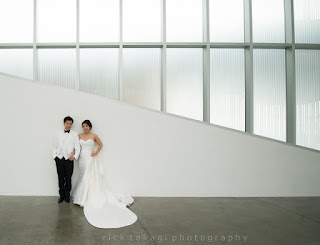 White on white - Bonnie and Manson's wedding photo at the Chihuly Garden and Glass Museum - Kent Buttars, Seattle Wedding Officiant